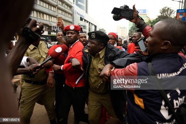 Musician turned politician Robert Kyagulanyi is arrested by police before he was whisked away by his supporters during a demonstration on July 11...