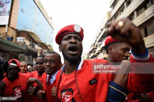 TOPSHOT Musician turned politician Robert Kyagulanyi Ssentamu aka Bobi Wine is joined by other activists in Kampala on July 11 2018 in Kampala during...