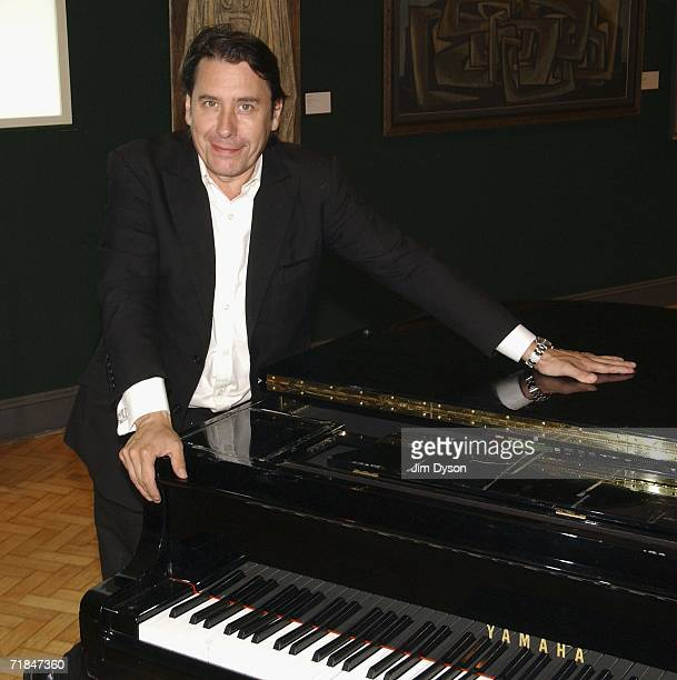 Musician TV presenter and bandleader Jools Holland poses with his longserving piano with which he has accompanied such stars as Tom Jones Paul...
