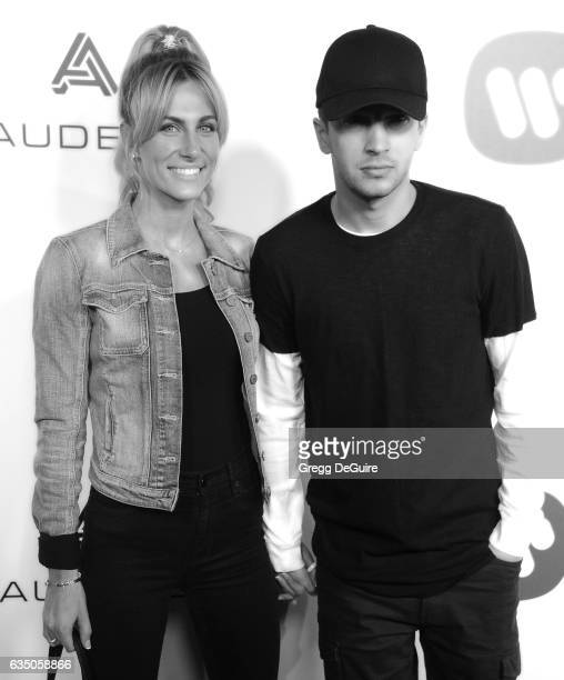 Musician Tyler Joseph of Twenty One Pilots and wife Jenna Black arrive at Warner Music Group's Annual GRAMMY Celebration at Milk Studios on February...