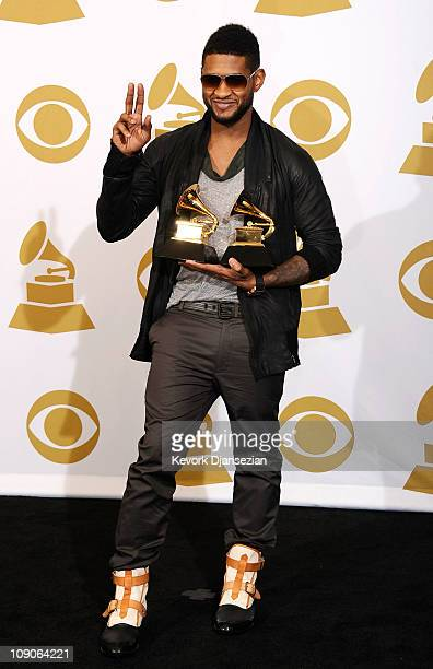 Musician Usher winner of the Best Male RB Vocal Performance award for 'There Goes My Baby' and the Best Contemporary RB Album award for 'Raymond vs...