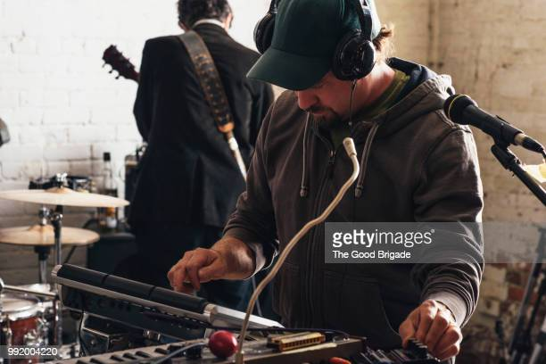 musician using synthesizer in recording studio - rehearsal stock pictures, royalty-free photos & images
