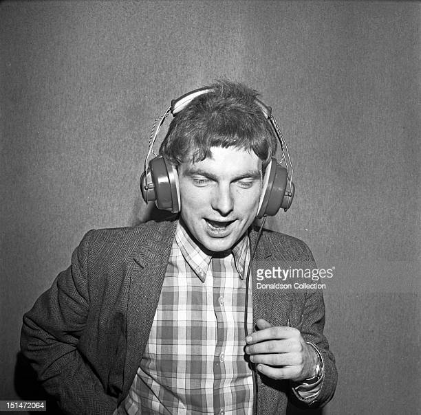 Musician Van Morrison listens back through headphones at a Bang Records recording session in the studio for Van Morrison's 1st album Blowing Your...