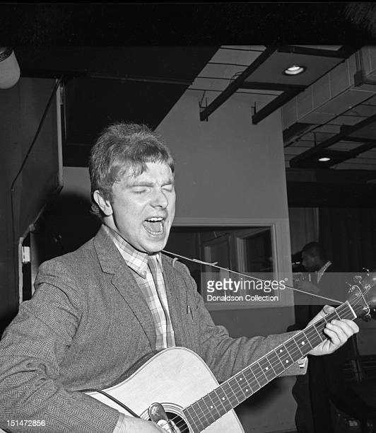 Musician Van Morrison plays a Martin acoustic guitar at a Bang Records recording session in the studio on March 28 1967 in New York New York