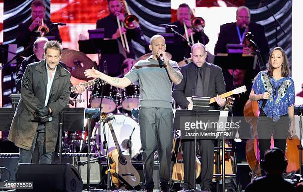 Musician Vicentico singer Rene Perez Joglar of and Ileana Cabra Joglar of Calle 13 perform onstage during the 2014 Person of the Year honoring Joan...