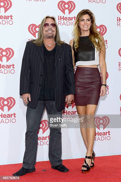 Musician Vince Neil of Motley Crue and Rain Andreani attend the 2014 iHeartRadio Music Festival at the MGM Grand Garden Arena on September 19 2014 in...
