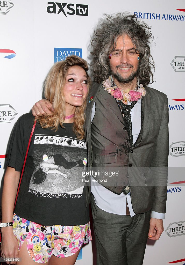 Musician Wayne Coyne (R) of The Flaming Lips with Katy Weaver arriving at The Music of David Lynch Benefiting the 10th anniversary of The David Lynch Foundation at The Ace Hotel Theater on April 1, 2015 in Los Angeles, California.