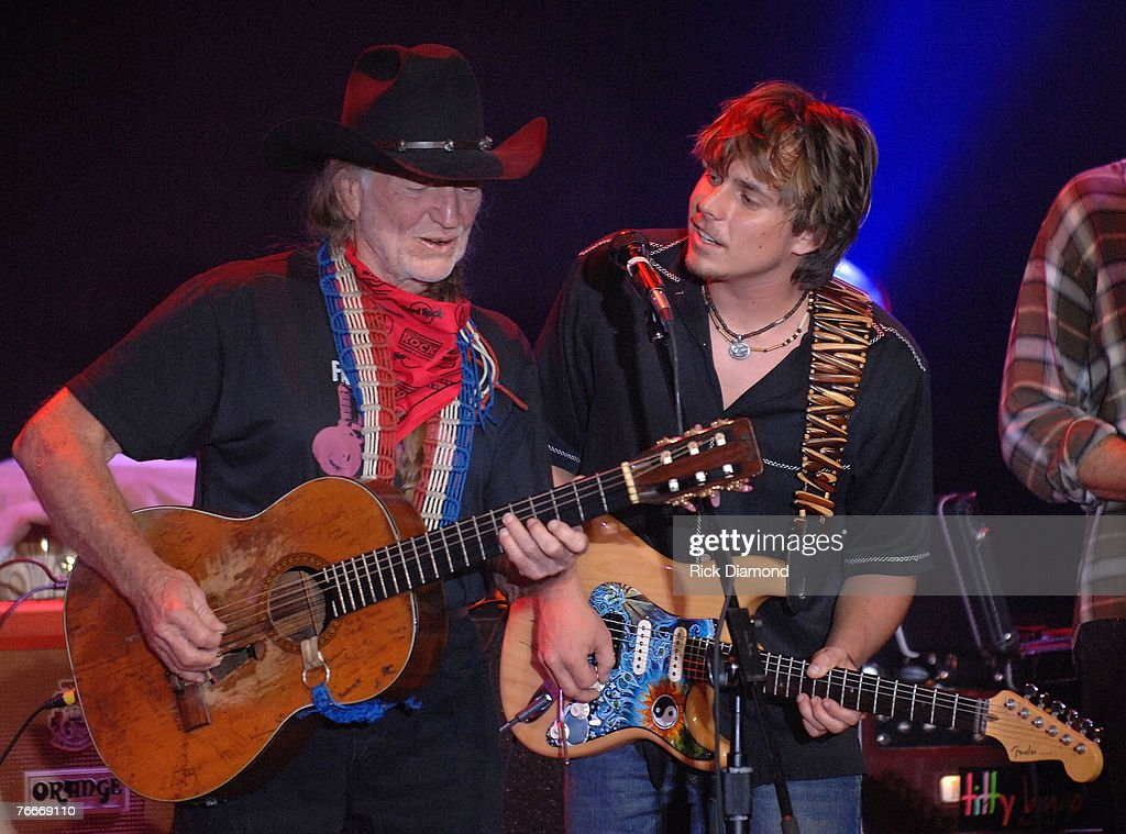 Musician, Willie Nelson (Center) along with Musician, Daughter Paula Nelson (Left) and Musician, Son Lukas Nelson (Right) preform live to help The Launch of the Sustainable Biodiesel Alliance at the Hard Rock Cafe in New York City on September 10,2007.