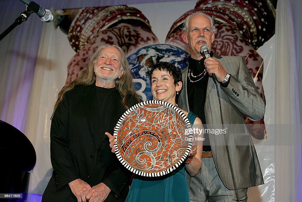 Musician Willie Nelson, Christy Pipkin and social activist/author/filmmaker Turk Pipkin present the Nobelity Project's 'Feed The Peace' award to Willie at the Four Seasons Hotel on April 11, 2010 in Austin, Texas.