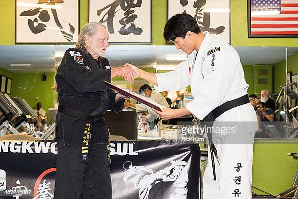 Musician Willie Nelson is presented with his 5th Degree Black Belt in the art of Gong Kwon Yu Sul by Grand Master Sam Um at his studio Master Martial...