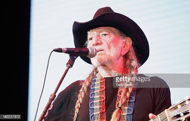 Musician Willie Nelson performs on stage during Global Green USA's 10th Annual PreOscar Party at Avalon on February 20 2013 in Hollywood California