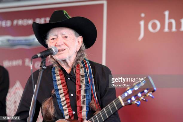 Musician Willie Nelson performs onstage at the John Varvatos 11th Annual Stuart House Benefit presented by Chrysler Kids Tent by by Hasbro at John...