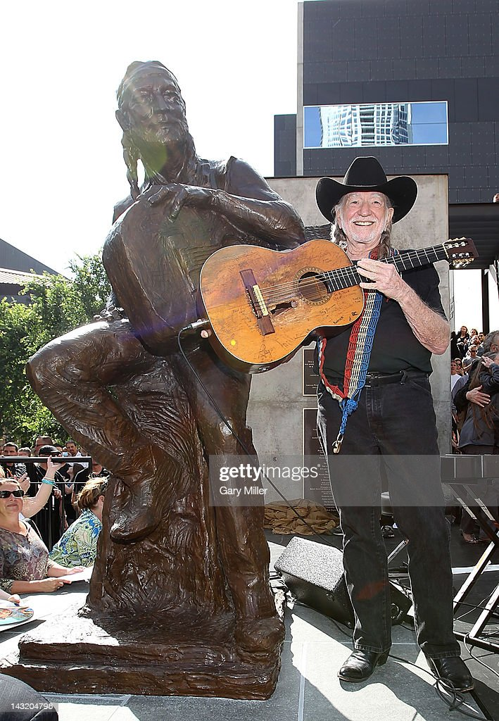 Musician Willie Nelson poses after the unveiling of his statue at ACL Live on April 20, 2012 in Austin, Texas.