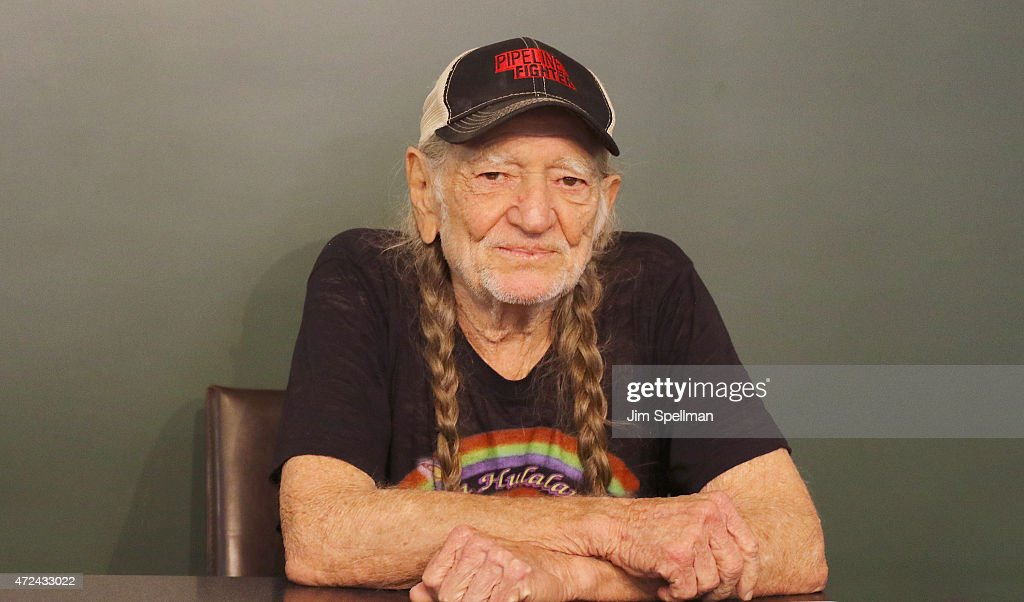 "Willie Nelson Signs Copies Of His Book ""It's A Long Story: My Life"""