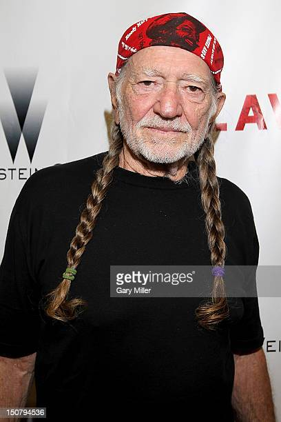 Musician Willie Nelson walks the red carpet for the new film Lawless at the Alamo Drafthouse on August 25 2012 in Austin Texas