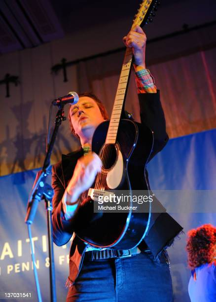 Musician Win Butler of Arcade Fire performs onstage at the Cinema For Peace event benefitting J/P Haitian Relief Organization in Los Angeles held at...