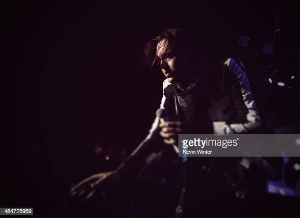Musician Win Butler of Arcade Fire performs onstage during day 3 of the 2014 Coachella Valley Music Arts Festival at the Empire Polo Club on April 13...