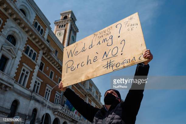 Musician with a sign in his hand, protests on the Lungomare in front of the Puglia Region on the first day in the orange zone for lack of support...
