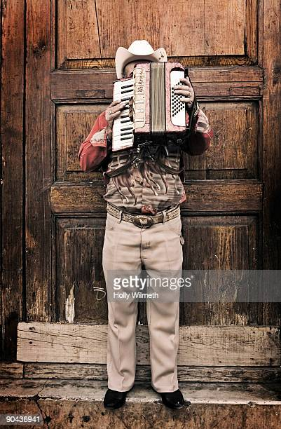 Musician with accordion in front of his face