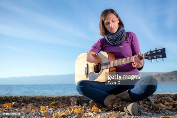 musician with disability plays guitar - campaigner stock pictures, royalty-free photos & images