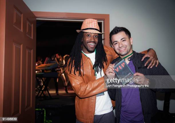 Musician with fan holding VIP pass backstage