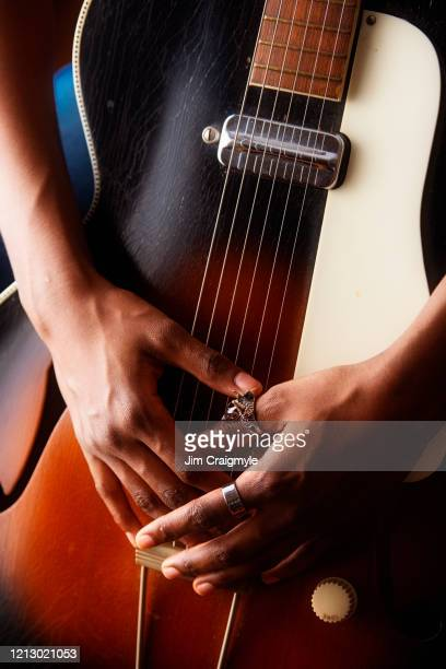 musician with hands clasped in front of guitar - songwriter stock pictures, royalty-free photos & images