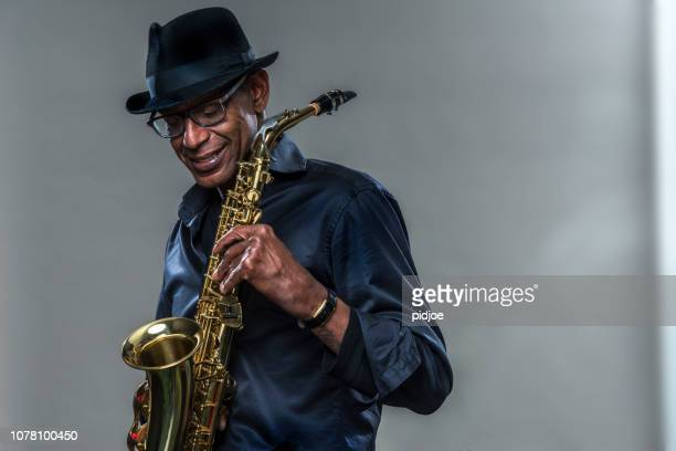musician with saxophone and big smile - jazz music stock pictures, royalty-free photos & images
