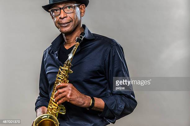 Musician with saxophone and big smile