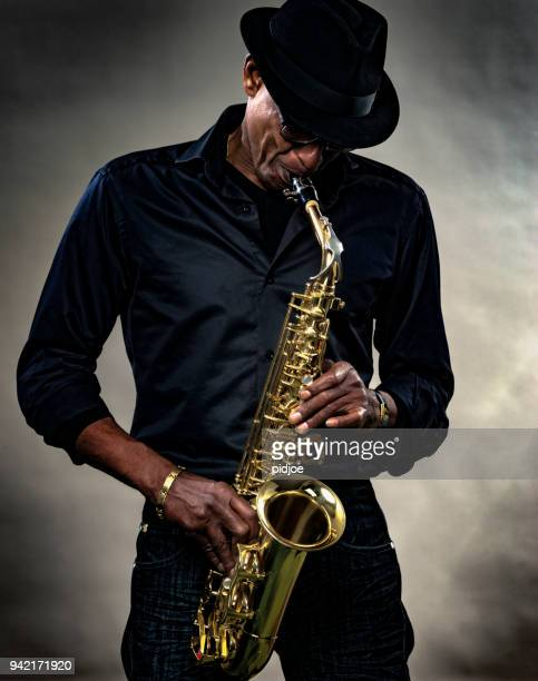 musician with saxophone - jazz stock pictures, royalty-free photos & images