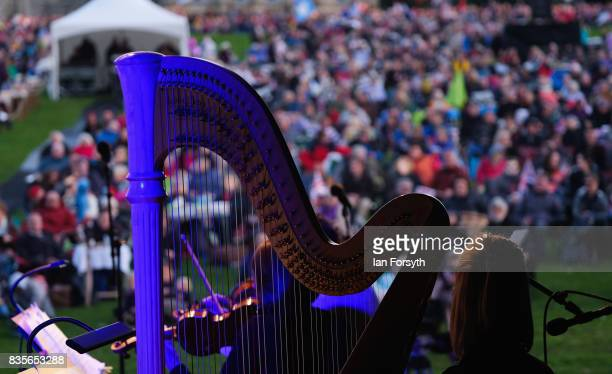 A musician with the London Gala Orchestra plays the harp as thousands of spectators attend the annual Castle Howard Proms Spectacular concert held on...