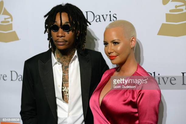 Musician Wiz Khalifa and Amber Rose walk the red carpet at Clive Davis annual PreGrammy Gala at The Beverly Hilton Hotel on February 11 2017 in...