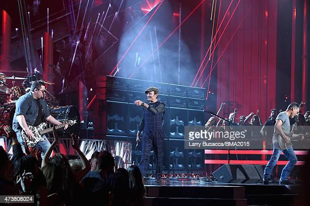 Musician Wolfgang Van Halen, singer David Lee Roth and musician Eddie Van Halen of Van Halen perform onstage at the 2015 Billboard Music Awards at...