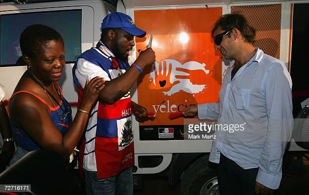 Musician Wyclef Jean and Jacmel Film Festival founder David Belle attend the launch of Yele Cinema at Jacmel City Hall December 1 2006 in Jacmel Haiti