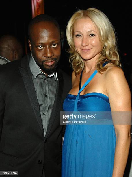 Musician Wyclef Jean and MP Belinda Stronach attend OneXOne at Maple Leaf Gardens on September 8 2008 in Toronto Canada