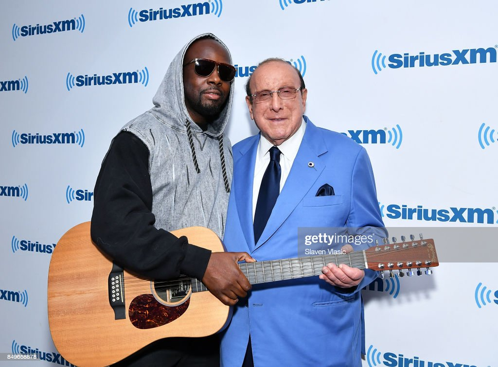 Musician Wyclef Jean (L) and producer Clive Davis visit SiriusXM Studios on September 19, 2017 in New York City.