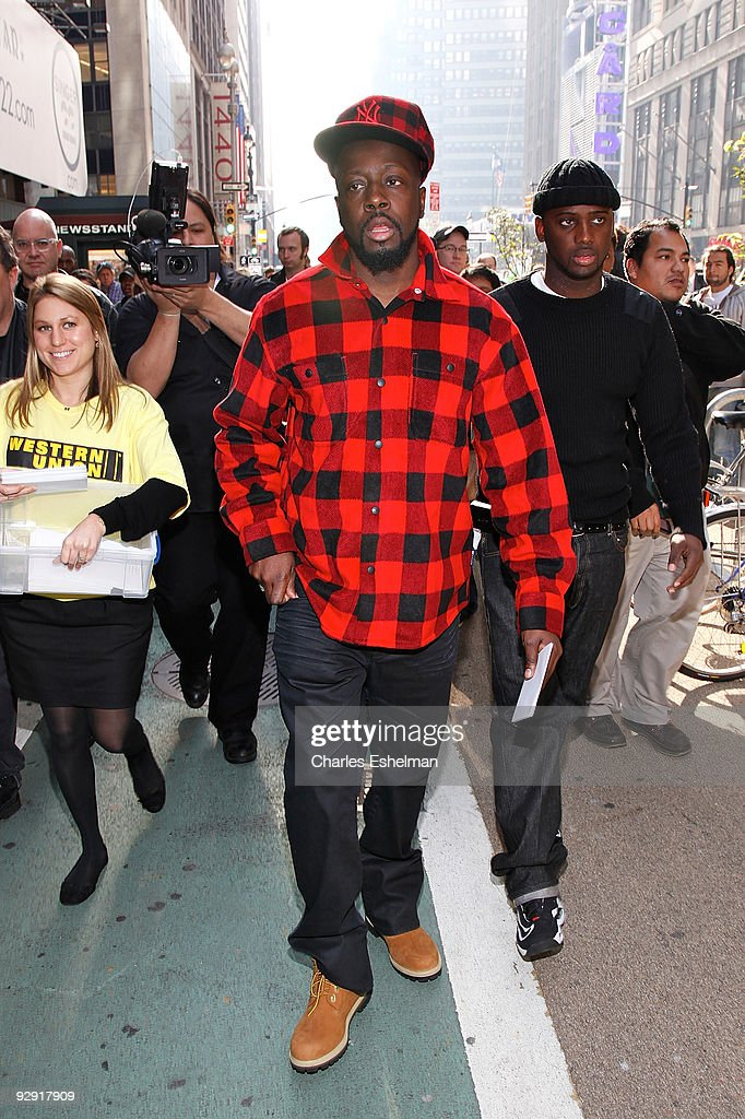 Musician Wyclef Jean attends Western Union's special holiday strategic alliance in Times Square on November 9, 2009 in New York City.