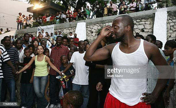 Musician Wyclef Jean talks with the crowd at the Yele Children's party on November 29 2006 in PortauPrince Haiti
