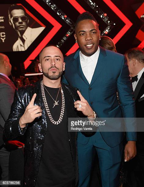 Musician Yandel and baseball player Aroldis Chapman attends the 2016 Person of the Year honoring Marc Anthony at the MGM Grand Garden Arena on...