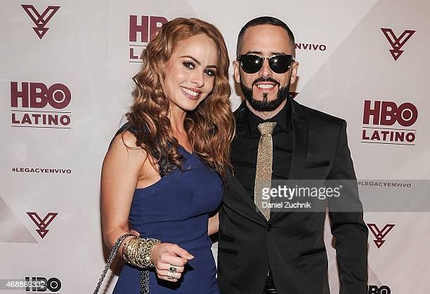 Musician Yandel with wife Edneris Espada Figueroa attend the HBO Latino red carpet premiere of the 'Camino Al Concierto and Legacy De Lider a...