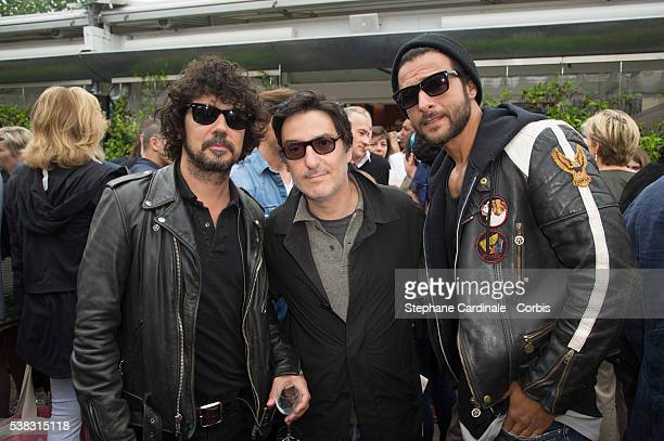 Musician Yarol Poupaud Director Yvan Attal and musician Maxime Nucci attend the French Tennis Open Day Fifteen with the Final between Novak Djokovic...