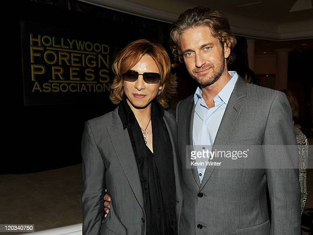Musician Yoshiki and actor Gerard Butler attend The Hollywood Foreign Press Association's 2011 Installation Luncheon at Beverly Hills Hotel on August...