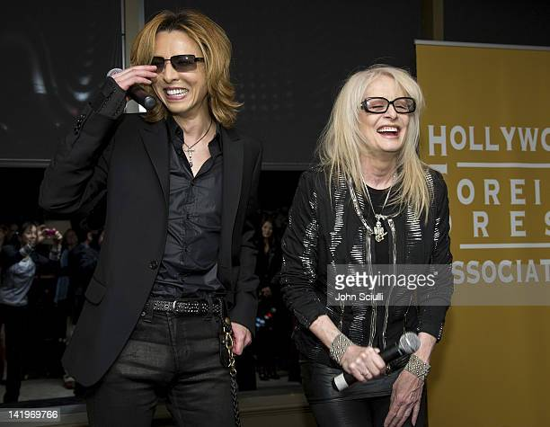 Musician Yoshiki and director Penelope Spheeris attend the HFPA's Golden Globe Awards Theme Song Listening Party with Yoshiki on March 23 2012 in...