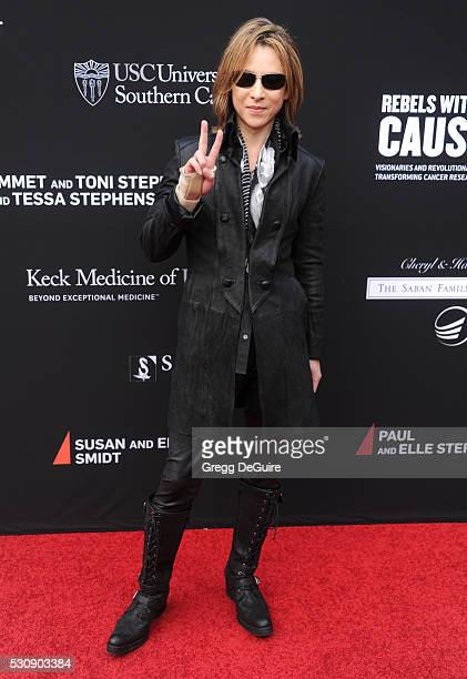 Musician Yoshiki arrives at the 3rd Biennial Rebels With A Cause Fundraiser at Barker Hangar on May 11 2016 in Santa Monica California