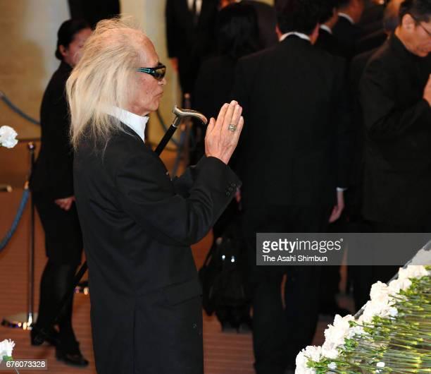 Musician Yuya Uchida offers a flower at an altar at the farewell meeting for late musician Hiroshi Kamayatsu on May 2, 2017 in Tokyo, Japan.