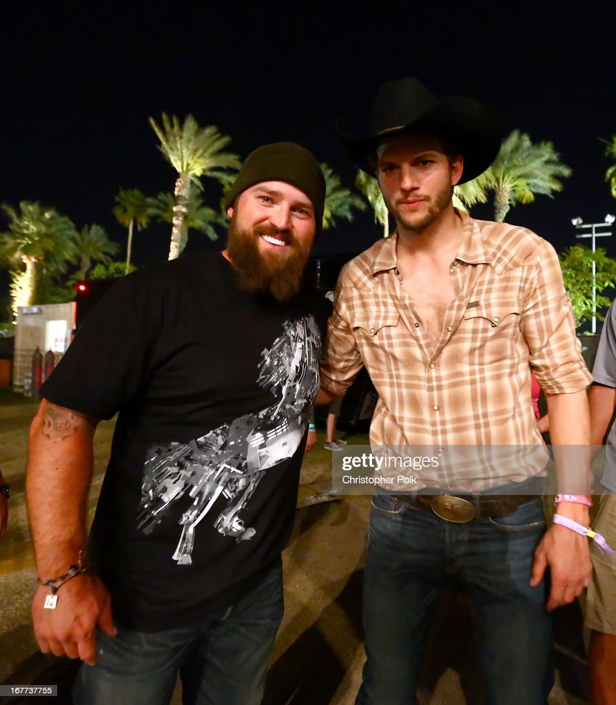 Musician Zac Brown (L) and actor Ashton Kutcher pose backstage during 2013 Stagecoach: California's Country Music Festival held at The Empire Polo Club on April 28, 2013 in Indio, California.