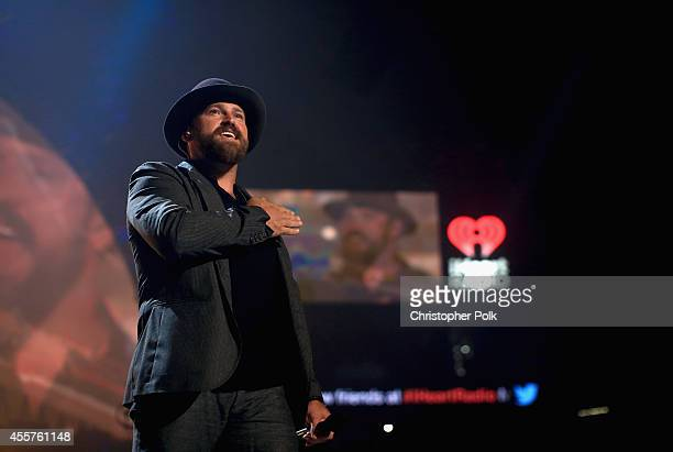 Musician Zac Brown performs onstage during the 2014 iHeartRadio Music Festival at the MGM Grand Garden Arena on September 19 2014 in Las Vegas Nevada