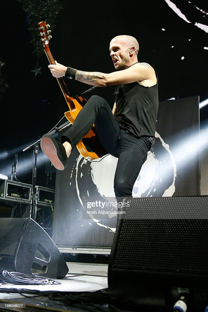 Musician Zach Blair of Rise Against performs at the 23rd Annual KROQ Almost Acoustic Christmas at Gibson Amphitheatre on December 8, 2012 in Universal City, California.