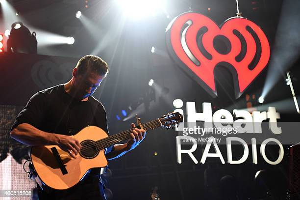 Musician Zach Filkins of OneRepublic performs onstage during HOT 995's Jingle Ball 2014 Presented by Mattress Warehouse at the Verizon Center on...