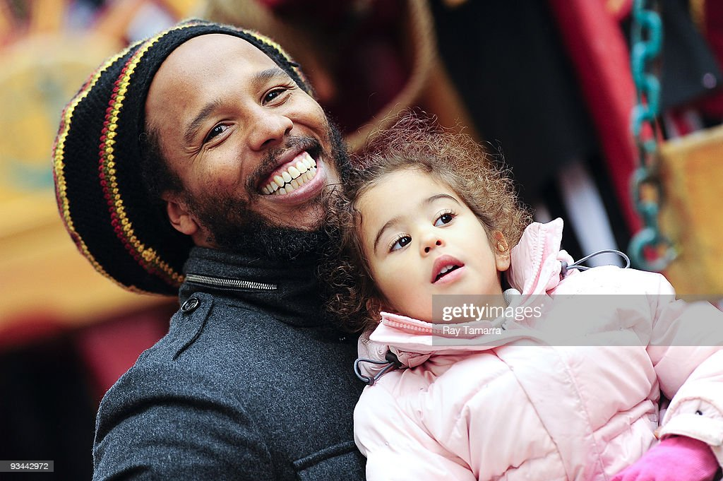 Musician Ziggy Marley (L) and his daughter Judah Marley attend the 83rd annual Macy's Thanksgiving Day Parade on the streets of Manhattan on November 26, 2009 in New York City.