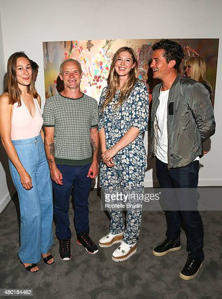 Musician/actor Flea and his girlfriend artist Petra Cortright and actor/producer Orlando Bloom attend the Depart Foundation's public opening and...